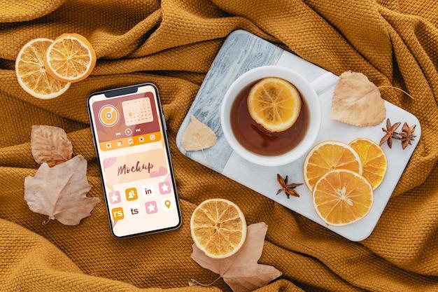 Top view arrangement with tea and smartphone