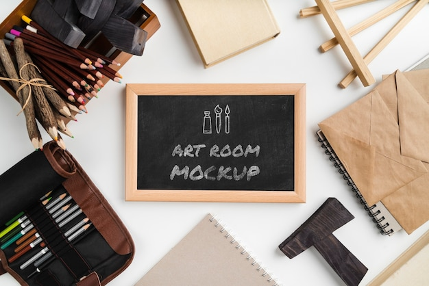 Top view artist painting tools and frame