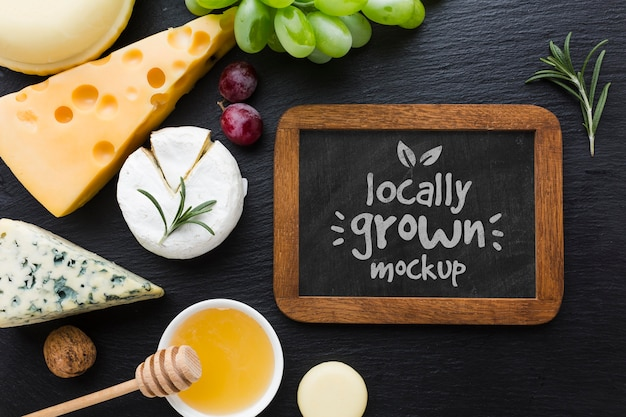 Top view of assortment of locally grown cheese with blackboard mock-up
