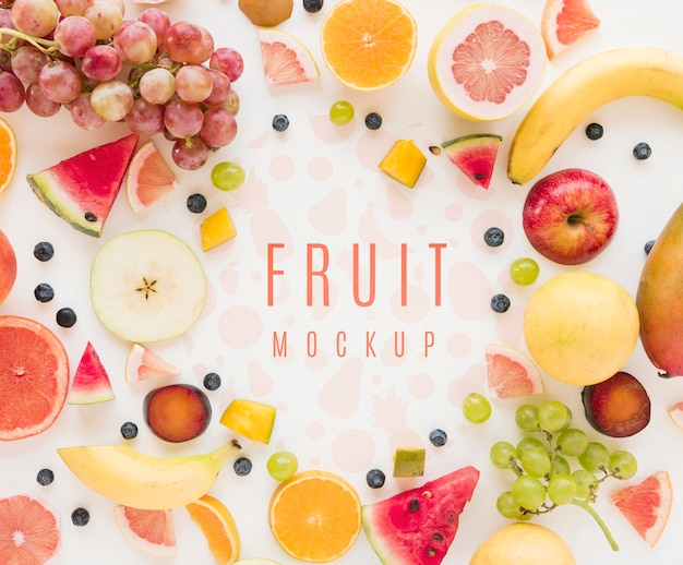 Top view assortment of organic fruits with mock-up