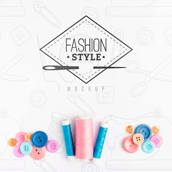 Top view assortment of sewing accessories with mock-up