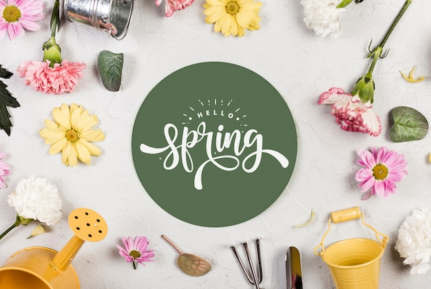 Top view of assortment of spring flowers and gardening tools