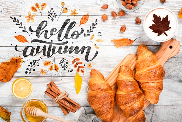 Top view autumn breakfast concept on wooden background