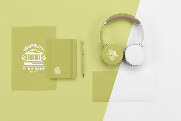 Top view of back to school headphones with notebooks and pen