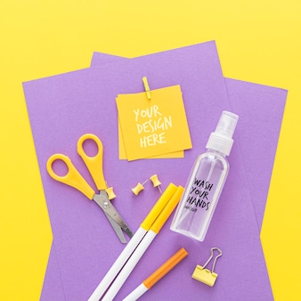 Top view of back to school items with scissors