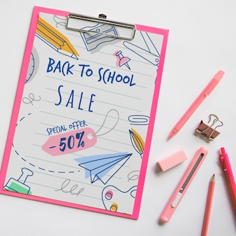 Top view back to school sale with clipboard and supplies
