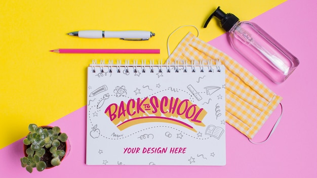 Vista dall'alto torna a materiale scolastico con mock-up