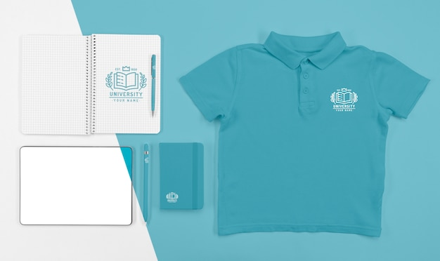 Top view of back to school t-shirt with notebooks and pen