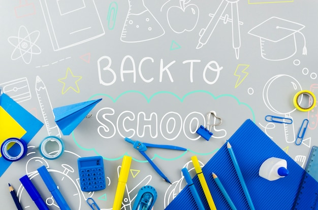 Top view back to school with blue supplies