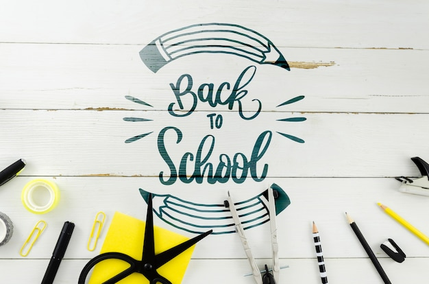 Top view back to school with wooden background