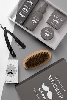 Top view of barbershop products box with brush and razor