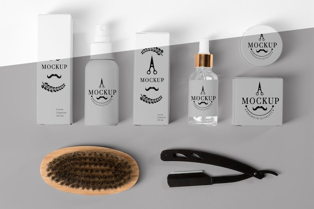 Top view of barbershop products set with serum and brush