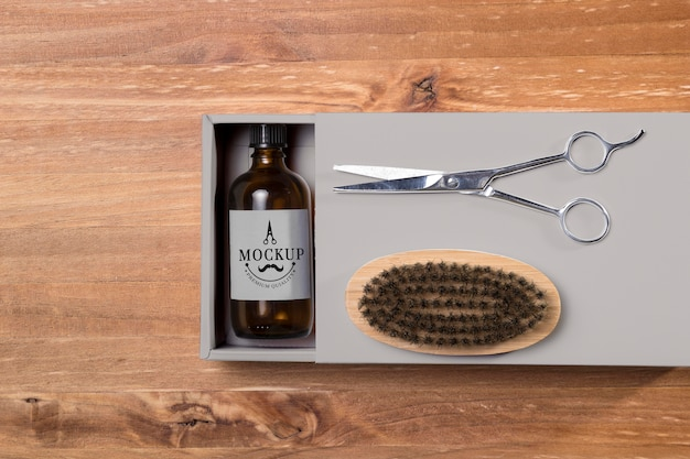 Top view of beard care products with balm and scissors