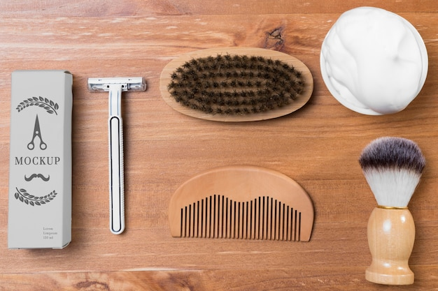 Top view of beard care products with shaving foam and razor