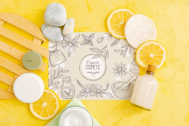 Top view of beauty cosmetics with citrus