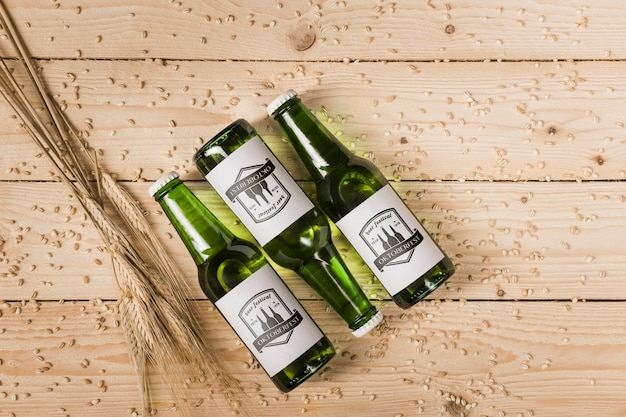 Top view beer bottles with wooden background