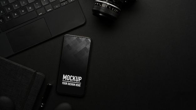 Top view of black table with smartphone mockup