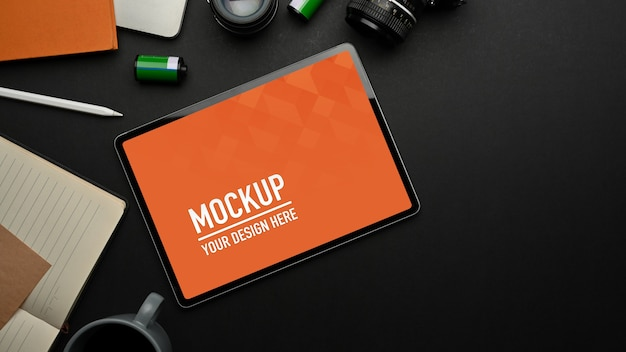 Top view of black table with tablet mockup
