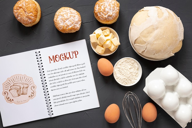 Top view of bread with ingredients and notebook