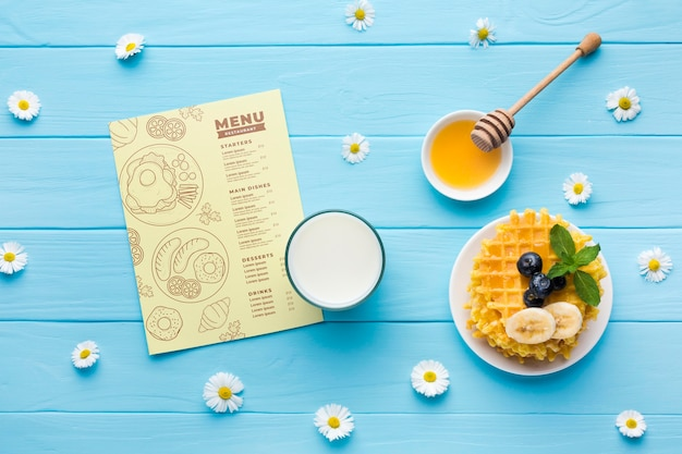 Top view of breakfast food with waffles and milk