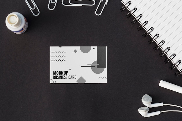 Top view of business card mock-up with earphones