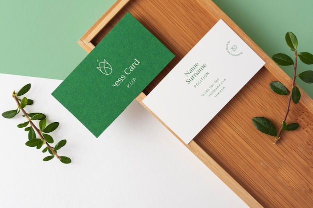 Top view business cards with wooden piece