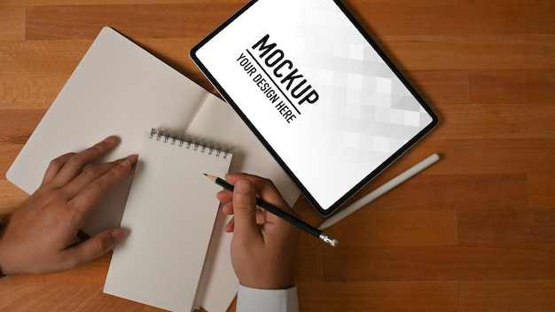 Top view of businessman working with tablet mockup