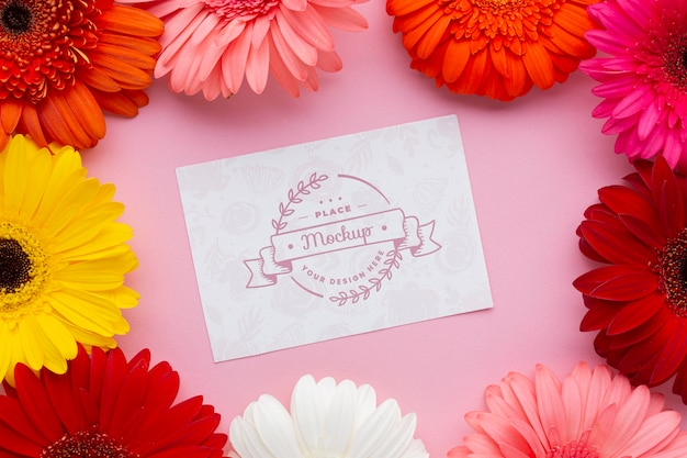Top view of card mock-up with daisies