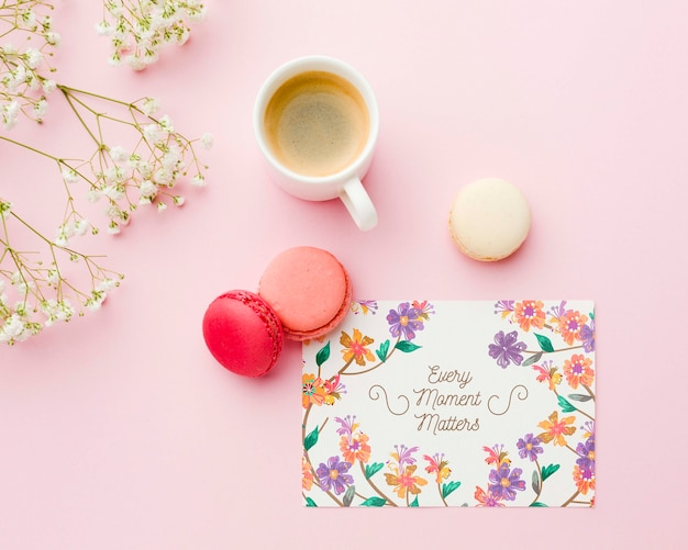 Top view of card with macarons and coffee cup