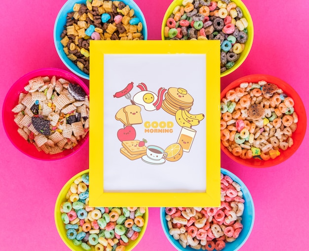Top view of cereal bowls and frame with pink background