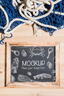 Top view of chalkboard with fishing net