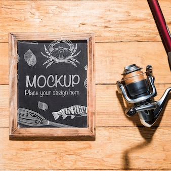 Top view of chalkboard with fishing rod