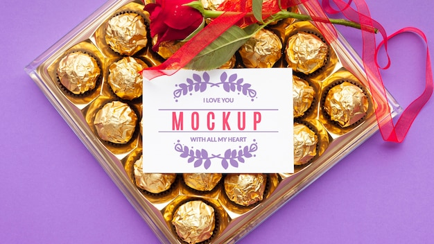 Top view chocolate and rose mock-up