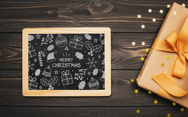 Top view of christmas concept chalkboard on wooden table