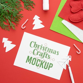 Top view of christmas crafts with paper and branch