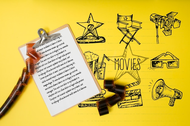 Top view cinema arrangement on yellow background
