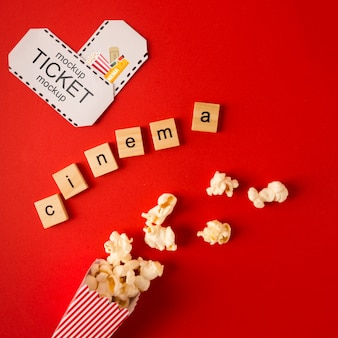 Top view cinema scrabble letters and tickets