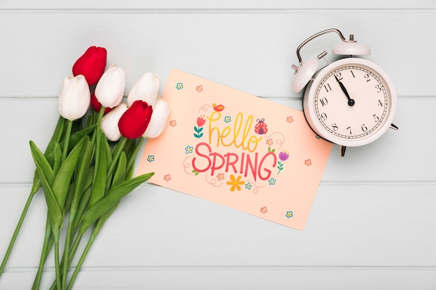 Top view of clock with card and spring tulips