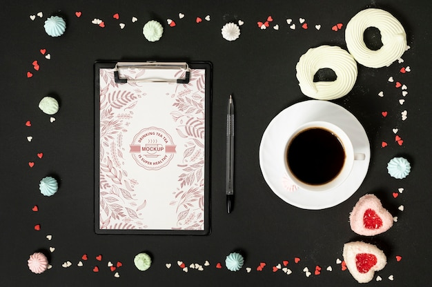 Top view coffee and candies clipboard mock-up