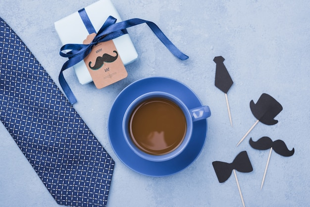 Top view of coffee with gift and tie for fathers day