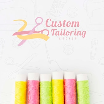 Top view collection of sewing thread with mock-up