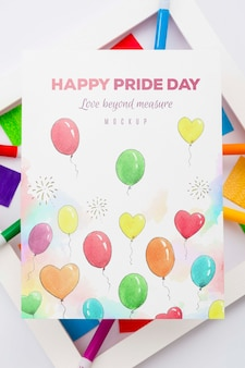 Top view of colorful balloons on paper with frame for lgbt pride