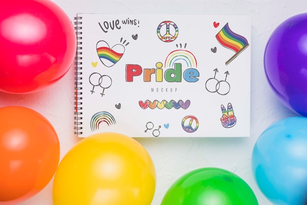 Top view of colorful balloons with notebook