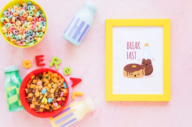 Top view of colorful cereals and frame on plain background