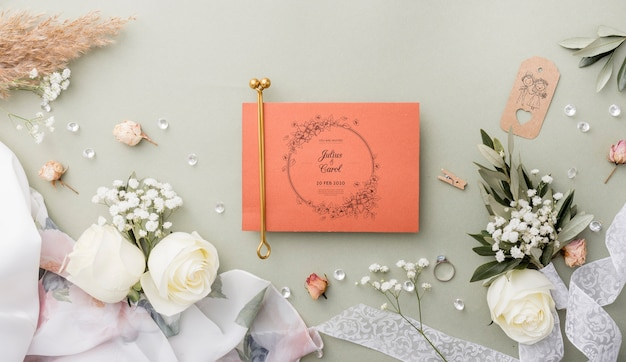 Top view composition of wedding elements with card mock-up