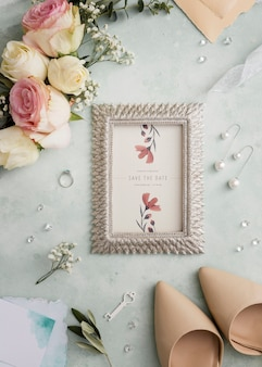 Top view composition of wedding elements with frame mock-up