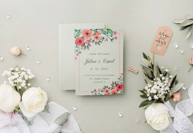 Top view composition of wedding elements with invitation mock-up
