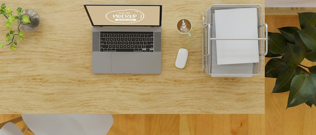 Top view of computer laptop and office paper filing trays on wooden table 3d render