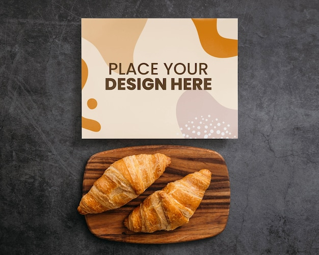 Top view on cooking book mockup design near pastries