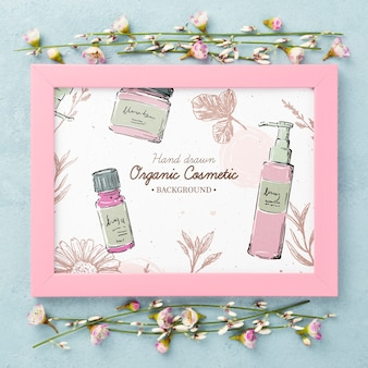Top view cosmetics mockup with flowers